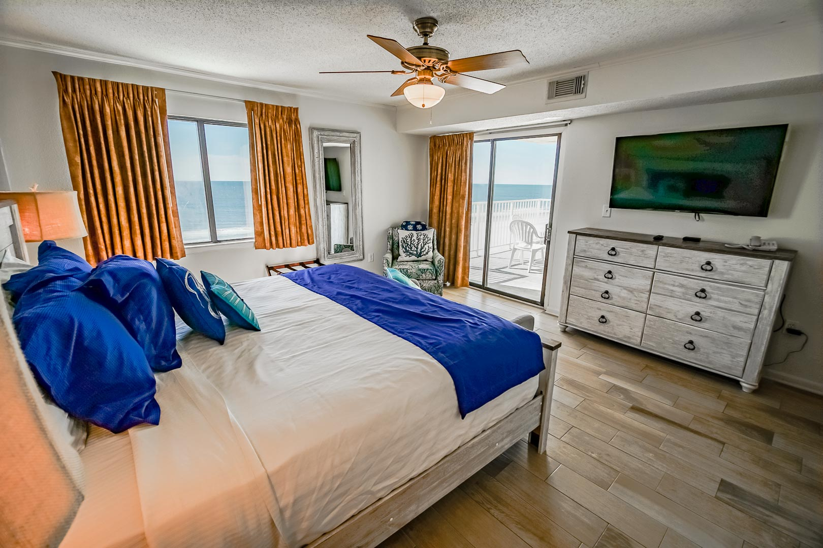 A beautiful master bedroom with an ocean view at VRI's Shoreline Towers in Gulf Shores, Alabama.