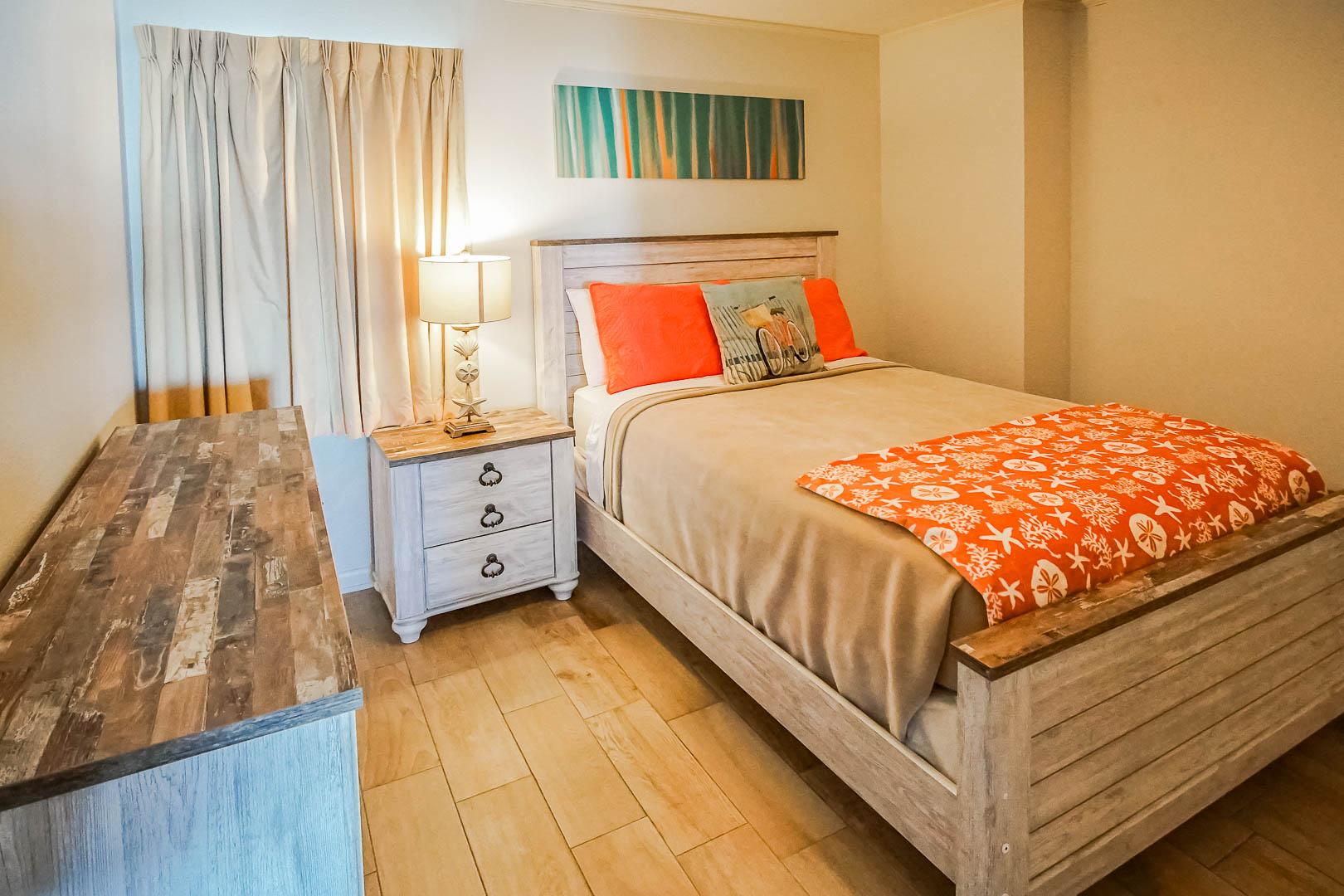 A vibrant bedroom at VRI's Shoreline Towers in Gulf Shores, Alabama.