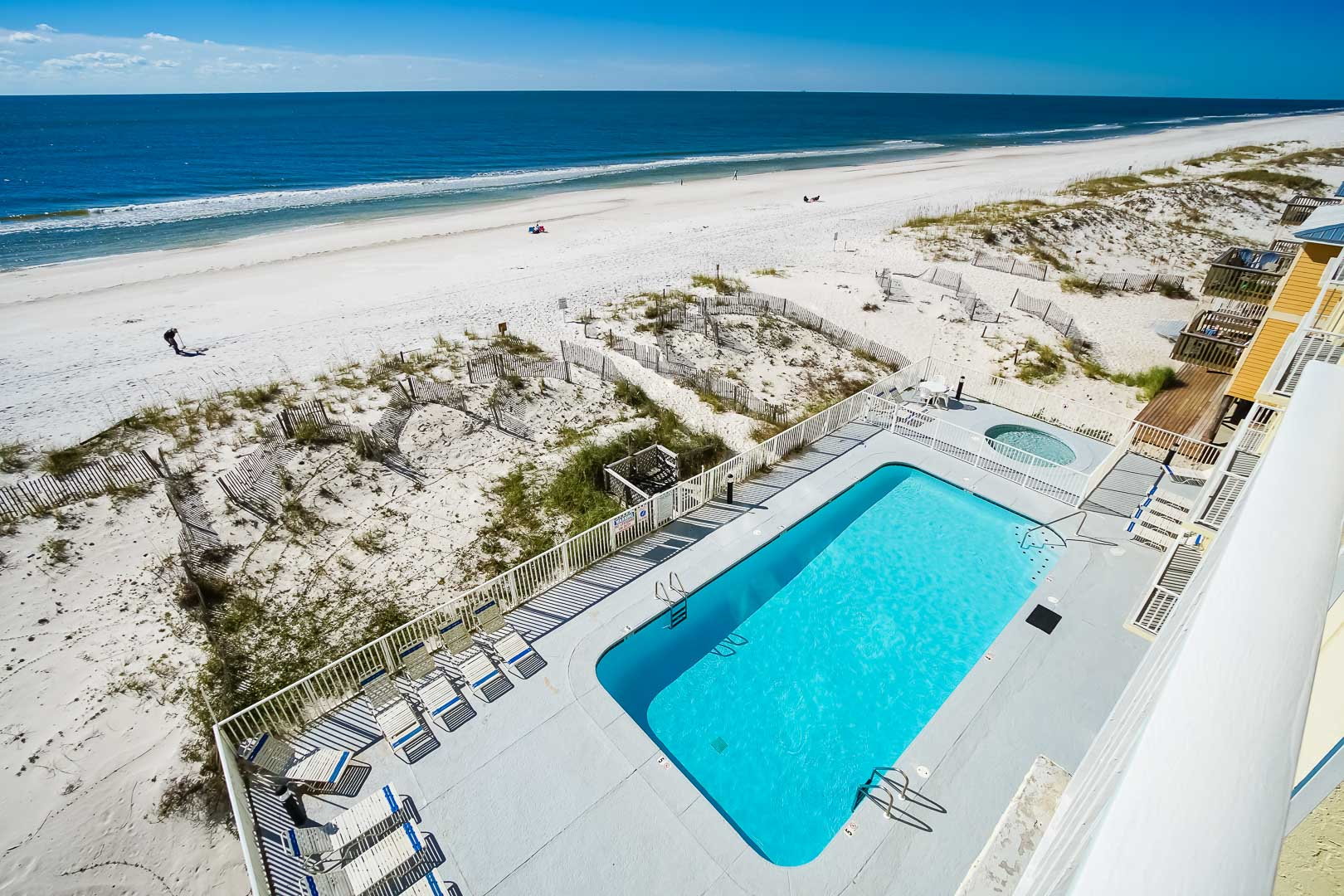 A crisp swimming pool next to the beach at VRI's Shoreline Towers in Gulf Shores, Alabama.