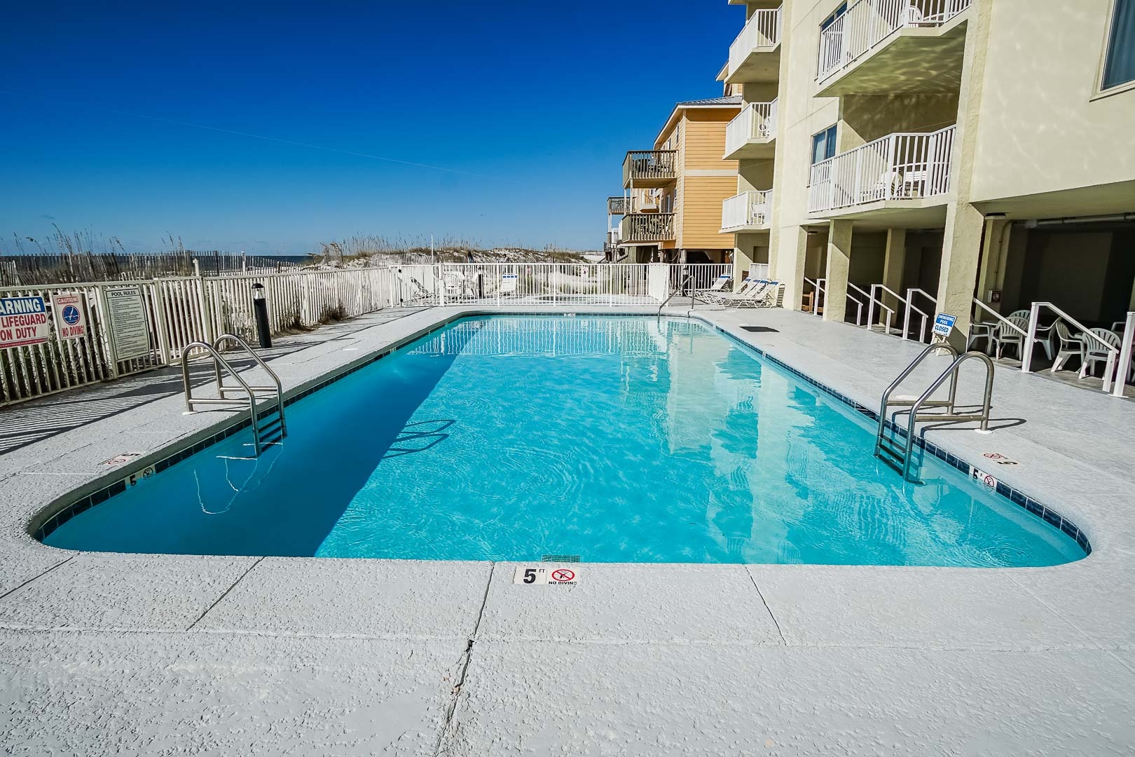 An expansive swimming pool at VRI's Shoreline Towers in Gulf Shores, Alabama.