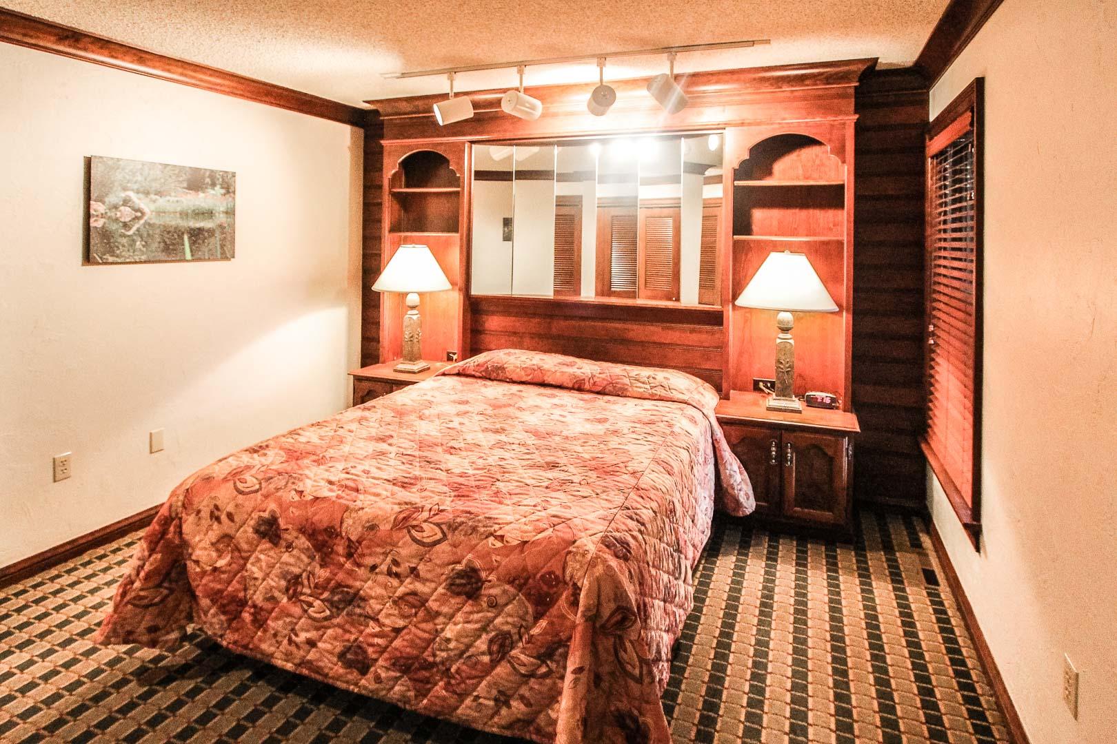 A cozy bedroom at VRI's Sunburst Resort in Steamboat Springs, Colorado.