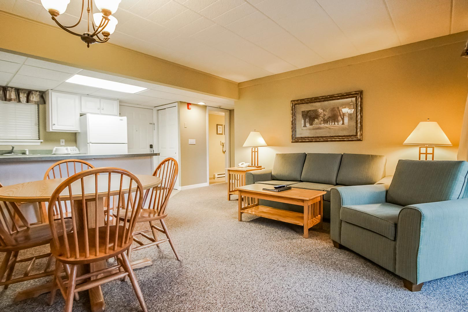 A cozy dining and living room area at VRI's Tanglwood Resort in Pennsylvania.