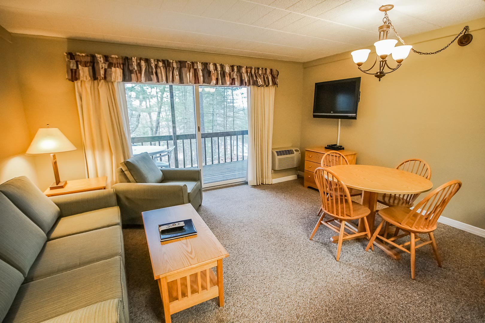A cozy living and dining area at VRI's Tanglwood Resort in Pennsylvania.