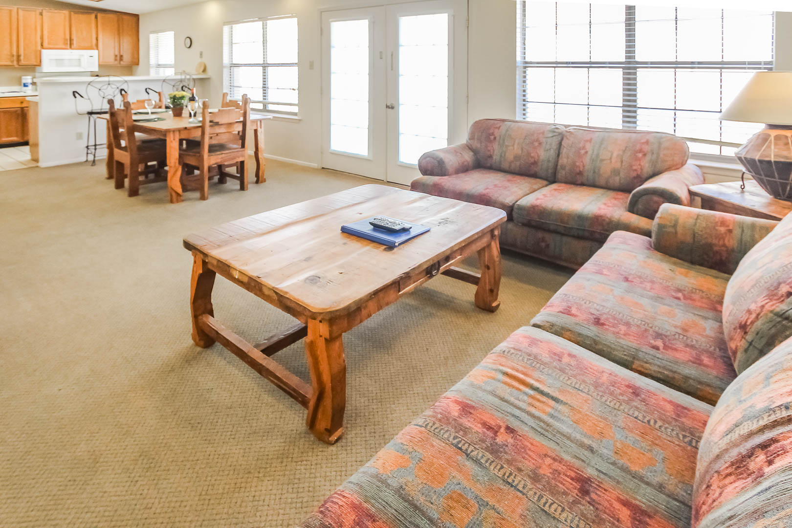 A spacious living room and kitchen  at VRI's Vacation Village at Lake Travis in Texas.