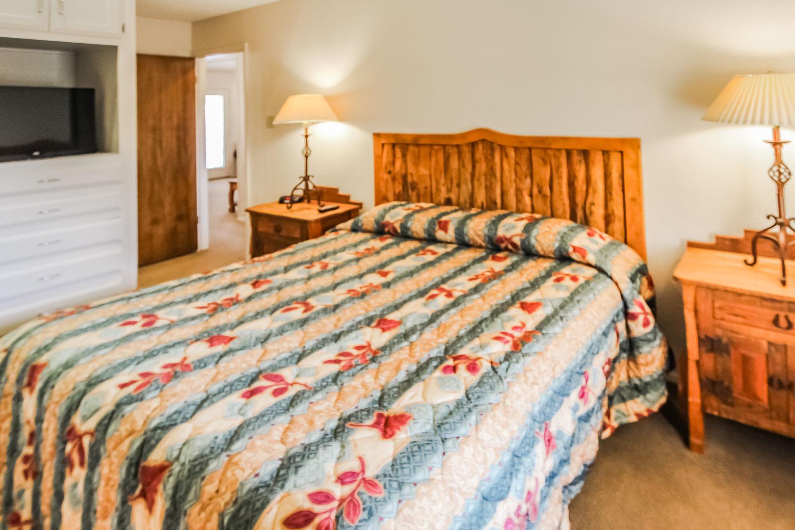 A spacious master bedroom at VRI's Vacation Village at Lake Travis in Texas.