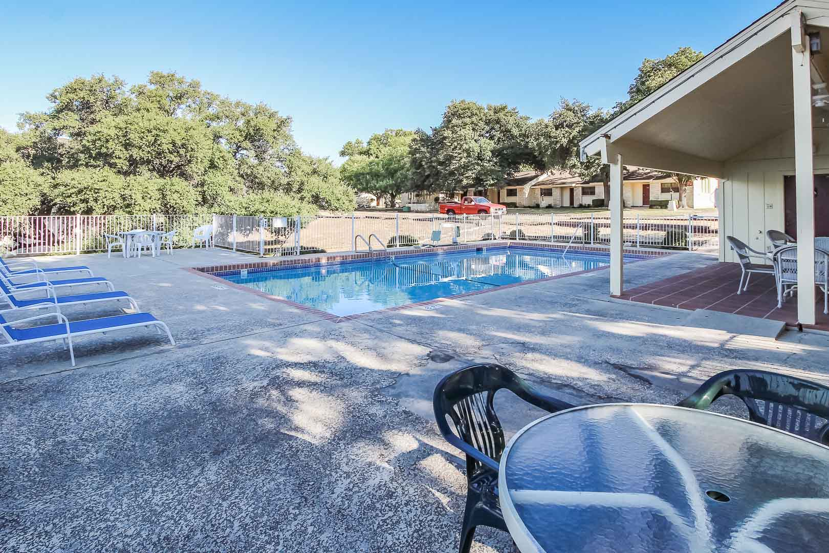 A peaceful outdoor swimming pool  at VRI's Vacation Village at Lake Travis in Texas.