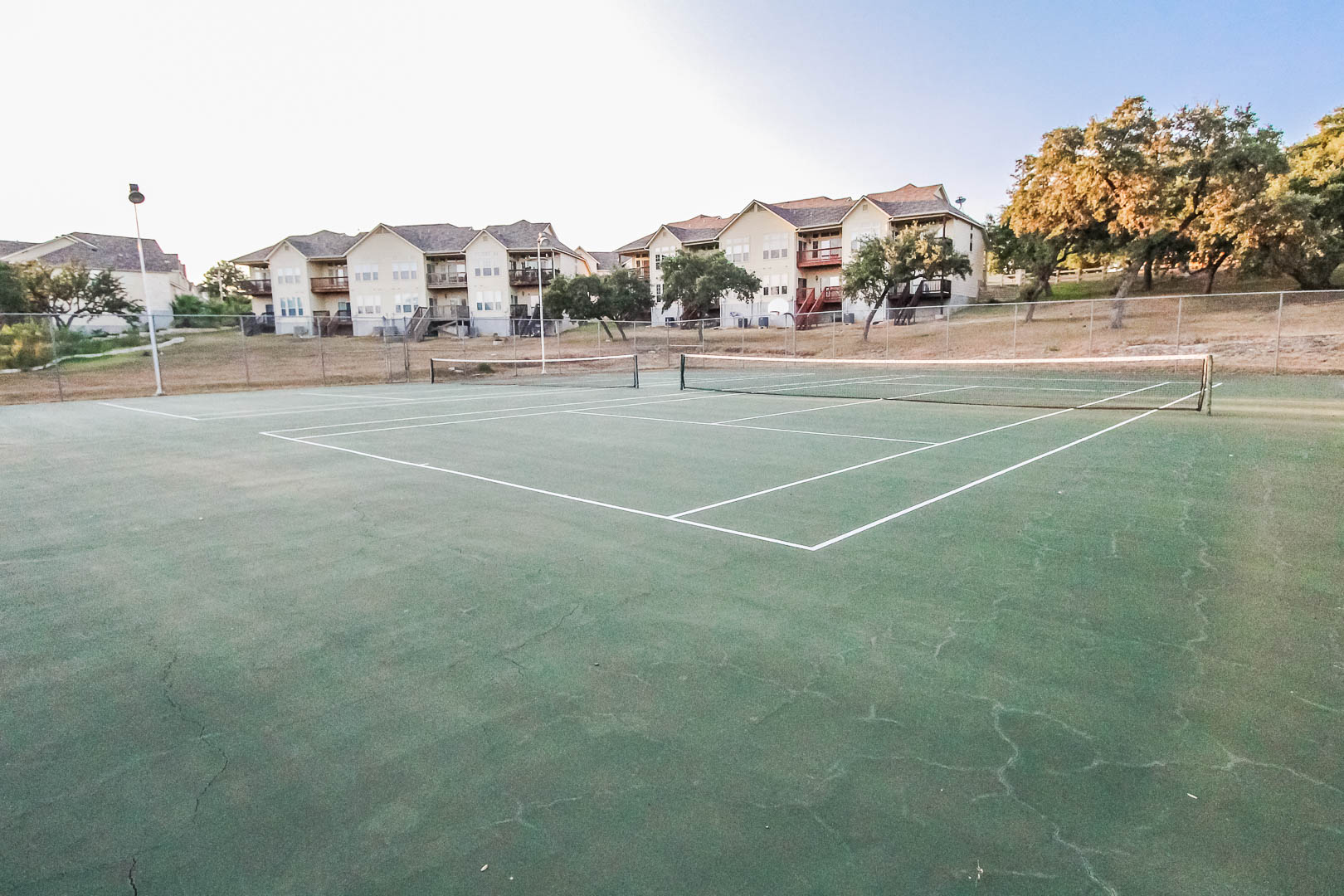 An inviting tennis court at VRI's Vacation Village at Lake Travis in Texas.