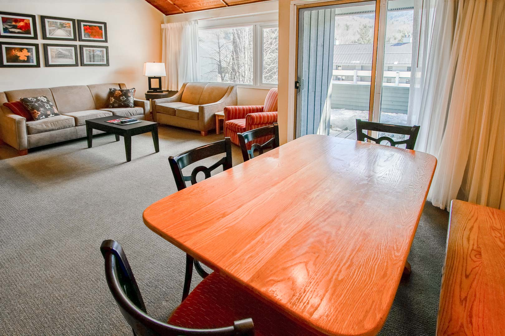 A spacious living and dining room area at VRI's Village of Loon Mountain in New Hampshire.