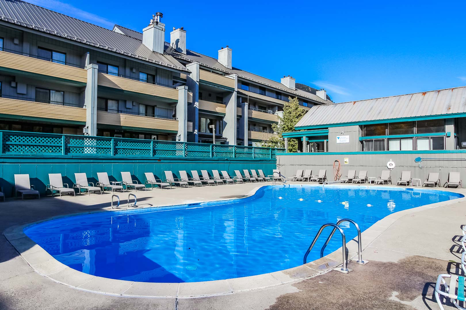 A spacious outdoor swimming pool at VRI's Village of Loon Mountain in New Hampshire.