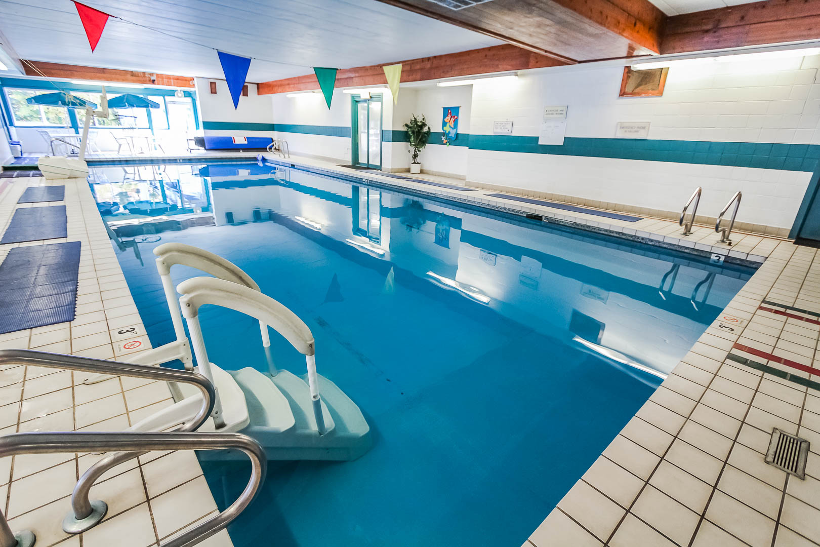 A spacious indoor swimming pool at VRI's Village of Loon Mountain in New Hampshire.