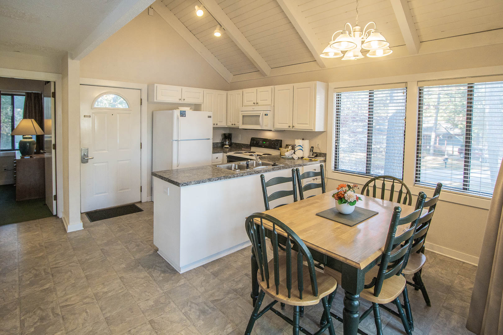 A spacious kitchen and dining room at VRI's Waterwood Townhomes in New Bern, North Carolina.