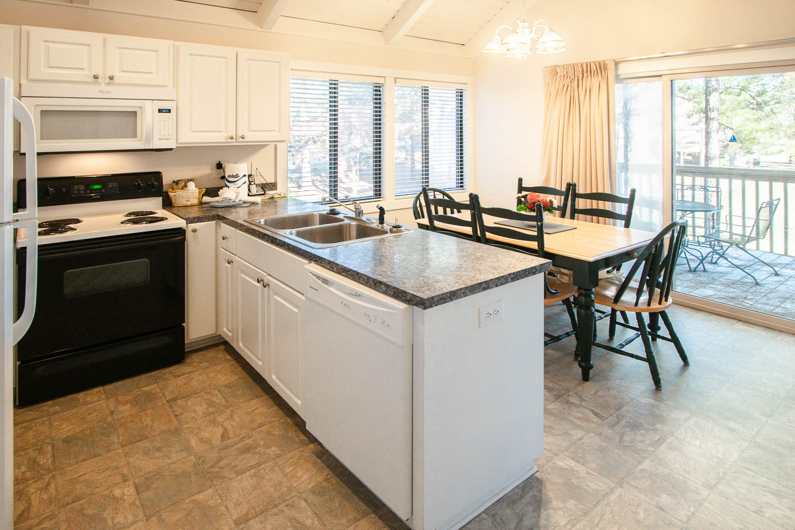 A fully equipped kitchen at VRI's Waterwood Townhomes in New Bern, North Carolina.