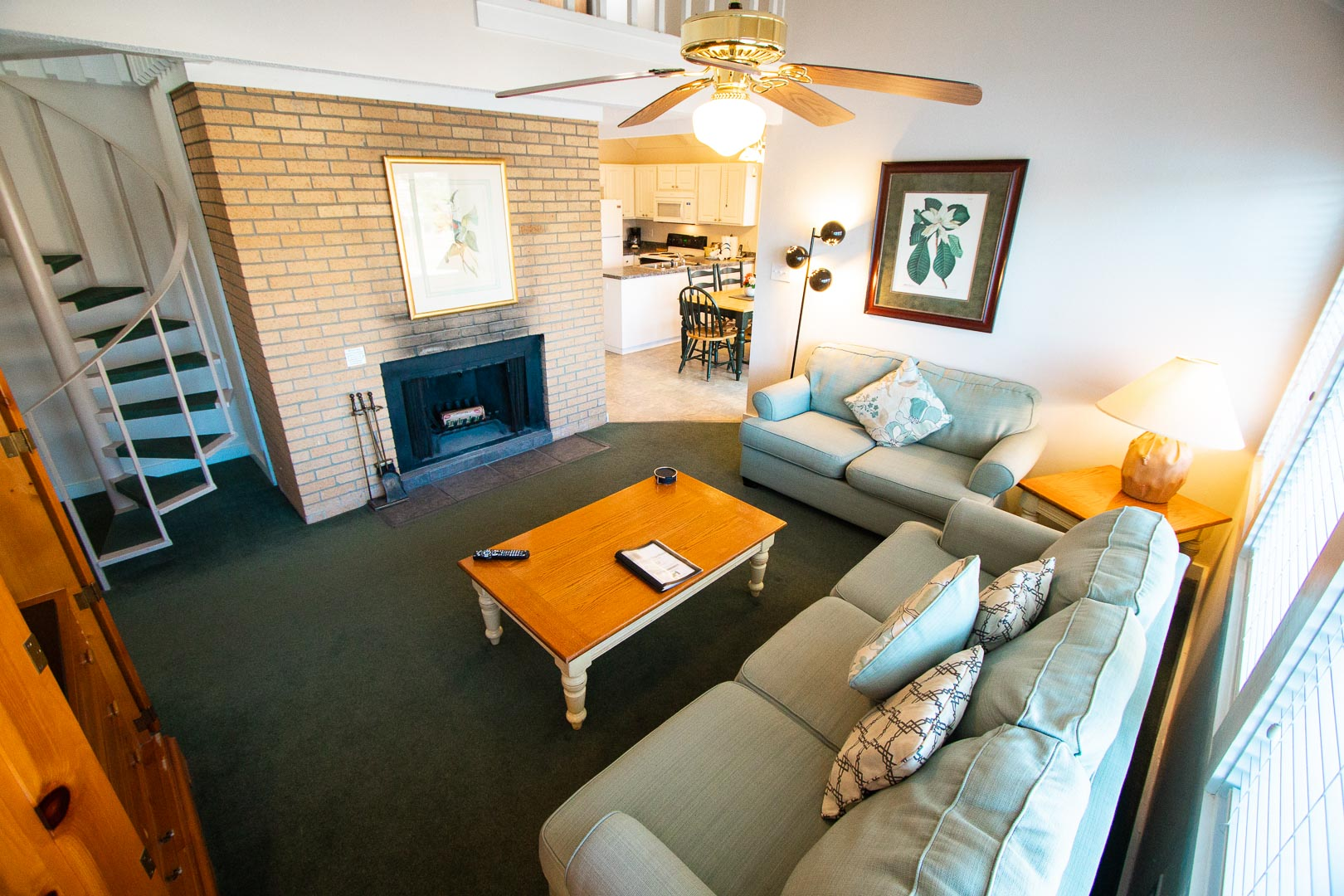 A view of the living room with staircase to the loft at VRI's Waterwood Townhomes in New Bern, North Carolina.