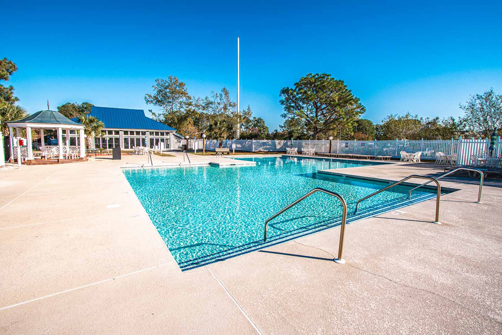 An outdoor swimming pool at VRI's Waterwood Townhomes in New Bern, North Carolina.