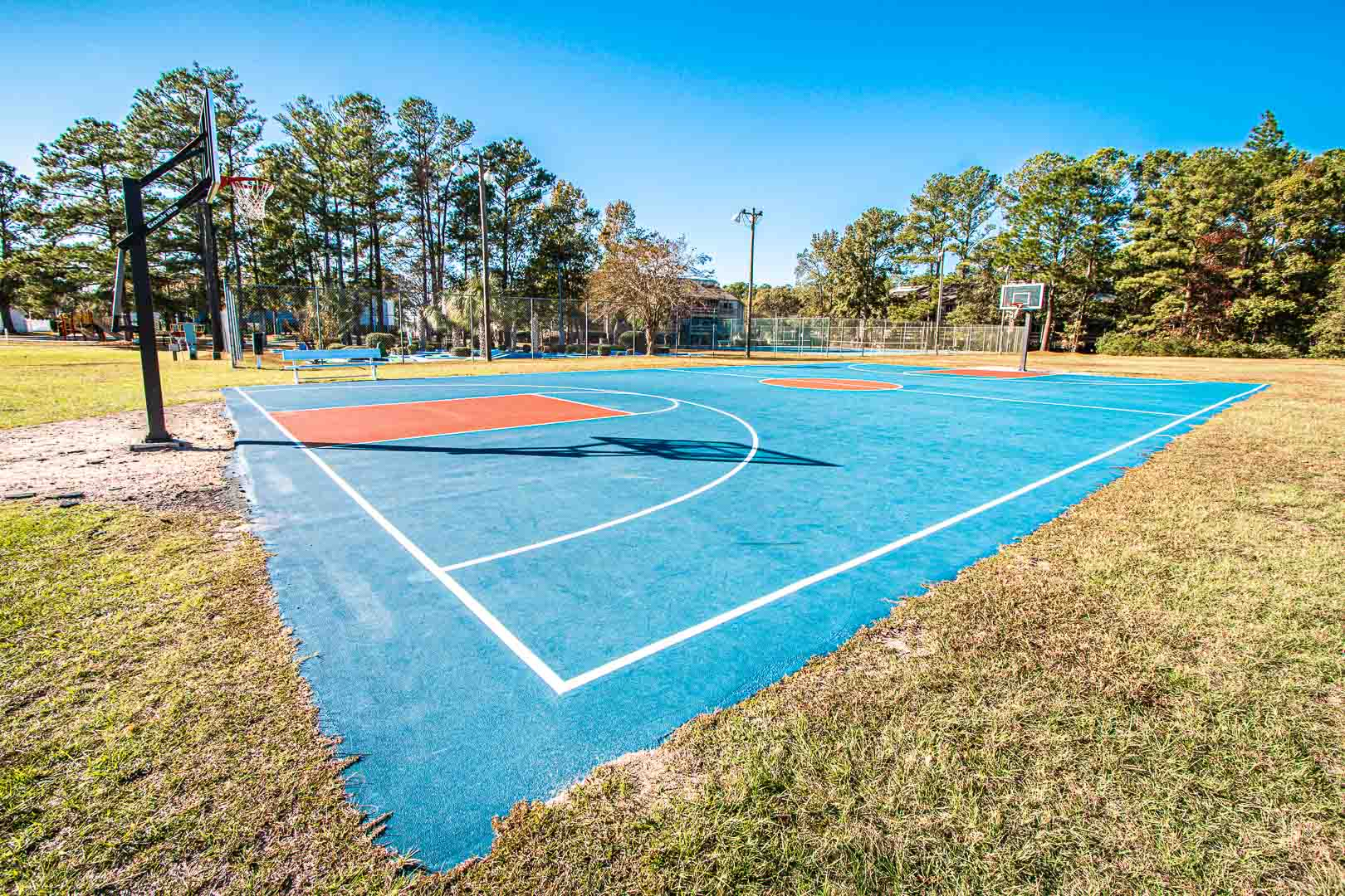 A spacious outdoor basketball court at VRI's Waterwood Townhomes in New Bern, North Carolina.