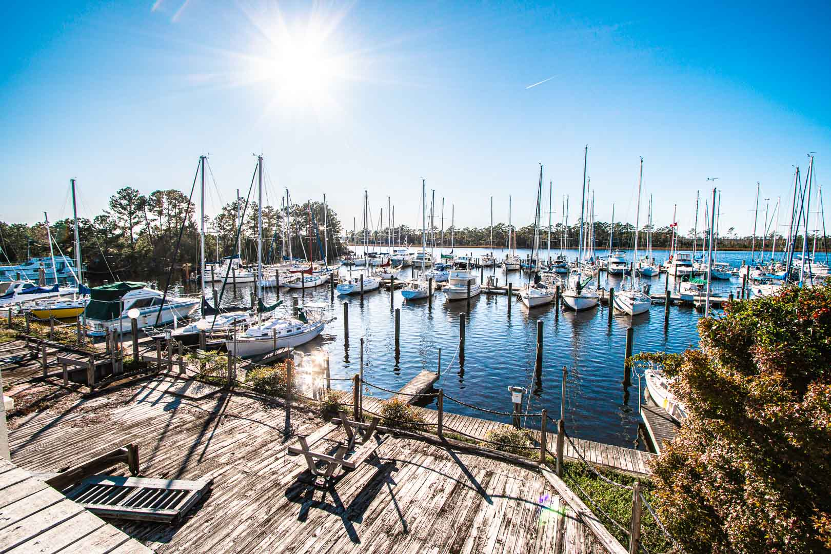 A peaceful view of the boat dock at VRI's Waterwood Townhomes in New Bern, North Carolina.