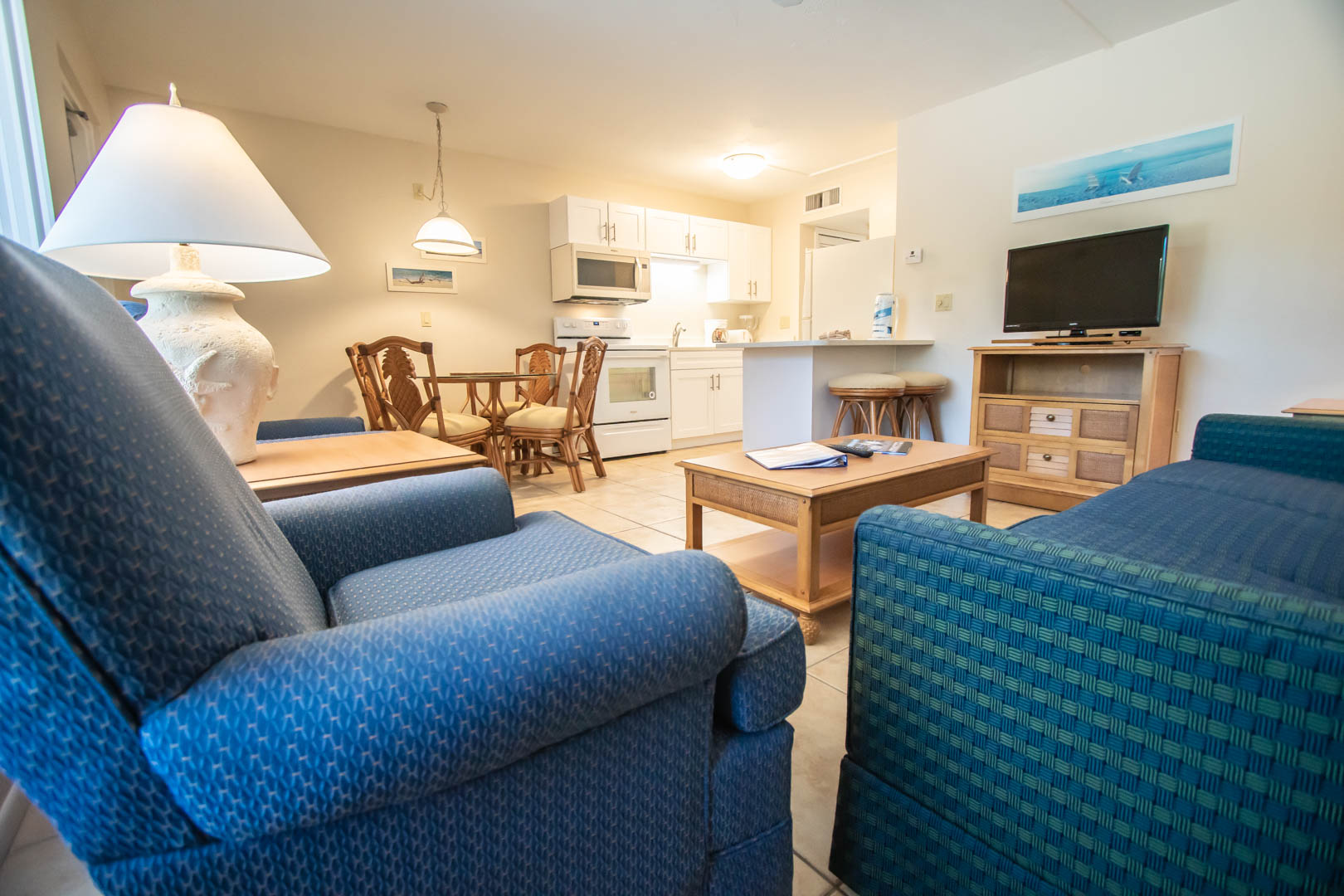 A spacious living room and kitchen view at VRI's Windward Passage Resort in Fort Myers Beach, Florida.