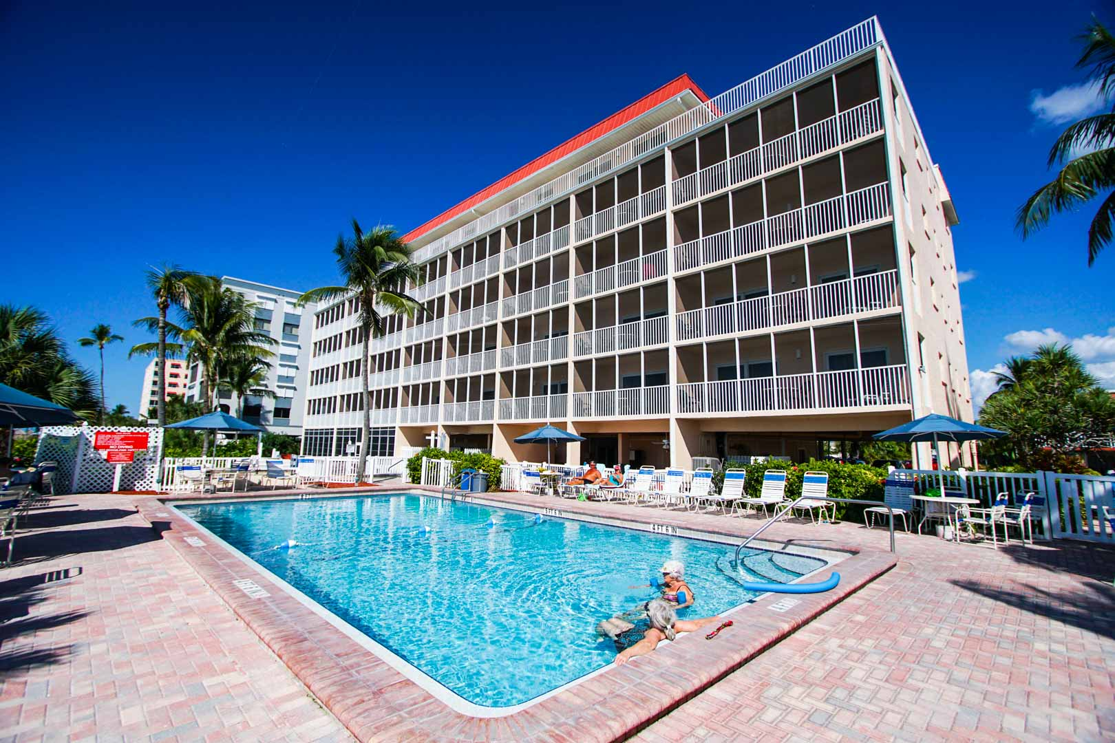 A crisp outdoor swimming pool at VRI's Windward Passage Resort in Fort Myers Beach, Florida.