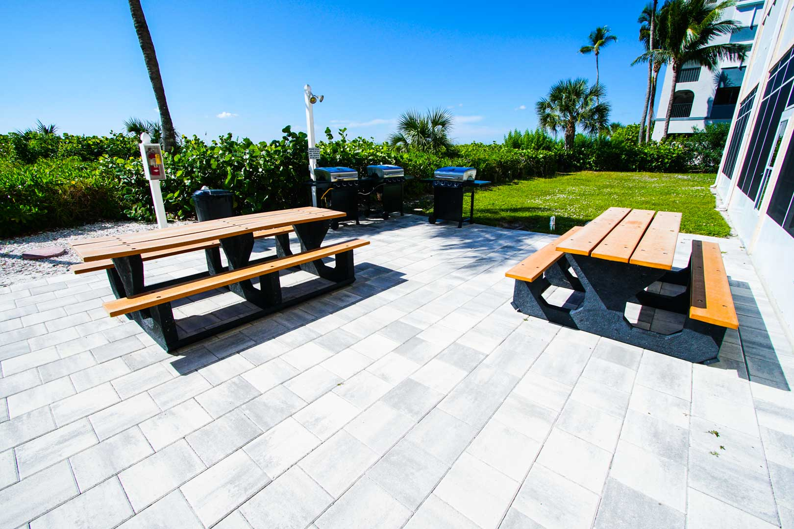 BBQ grills by the beach at VRI's Windward Passage Resort in Fort Myers Beach, Florida.