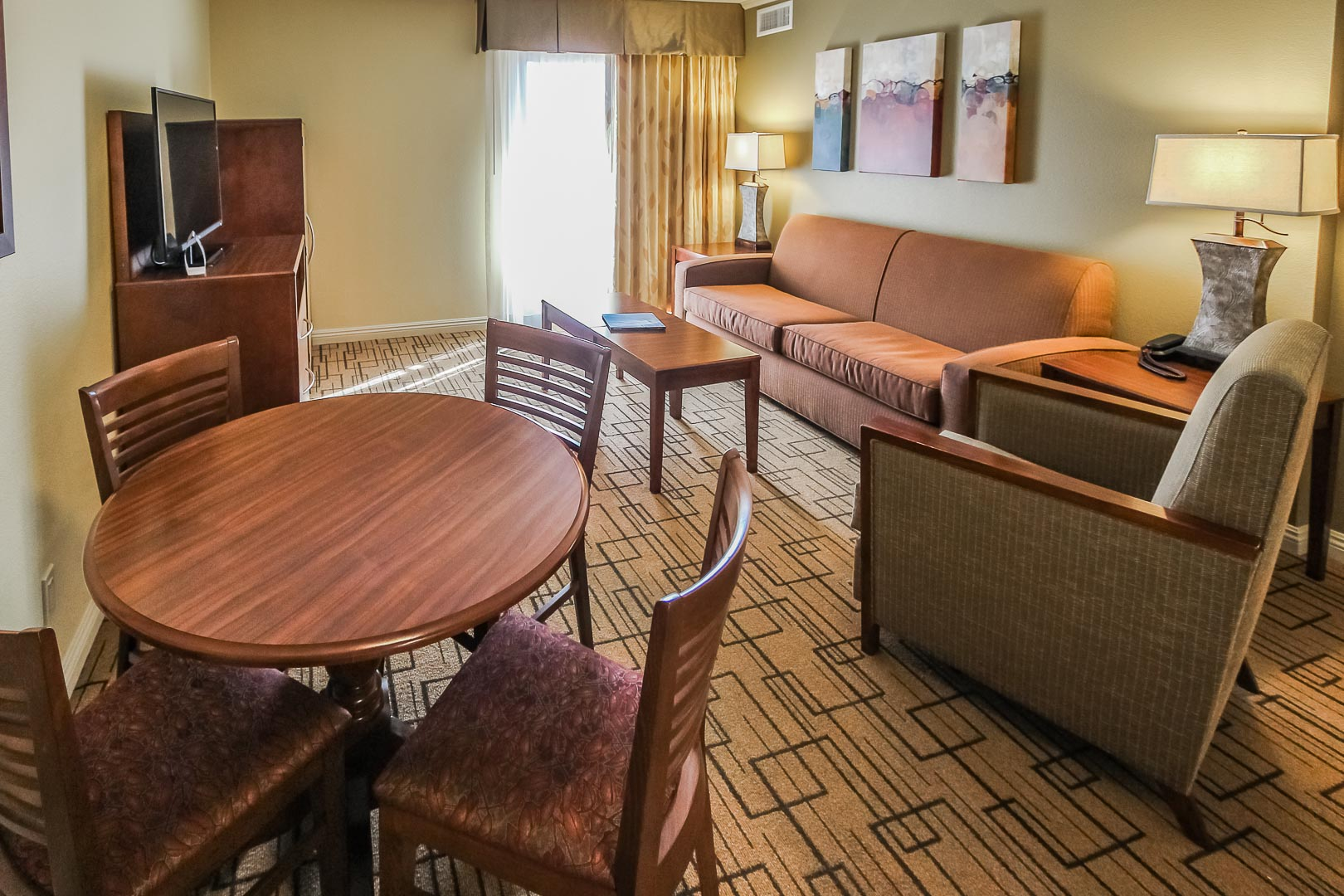 A standard One bedroom with living and dining room area at VRI's Winner Circle Resort in California.