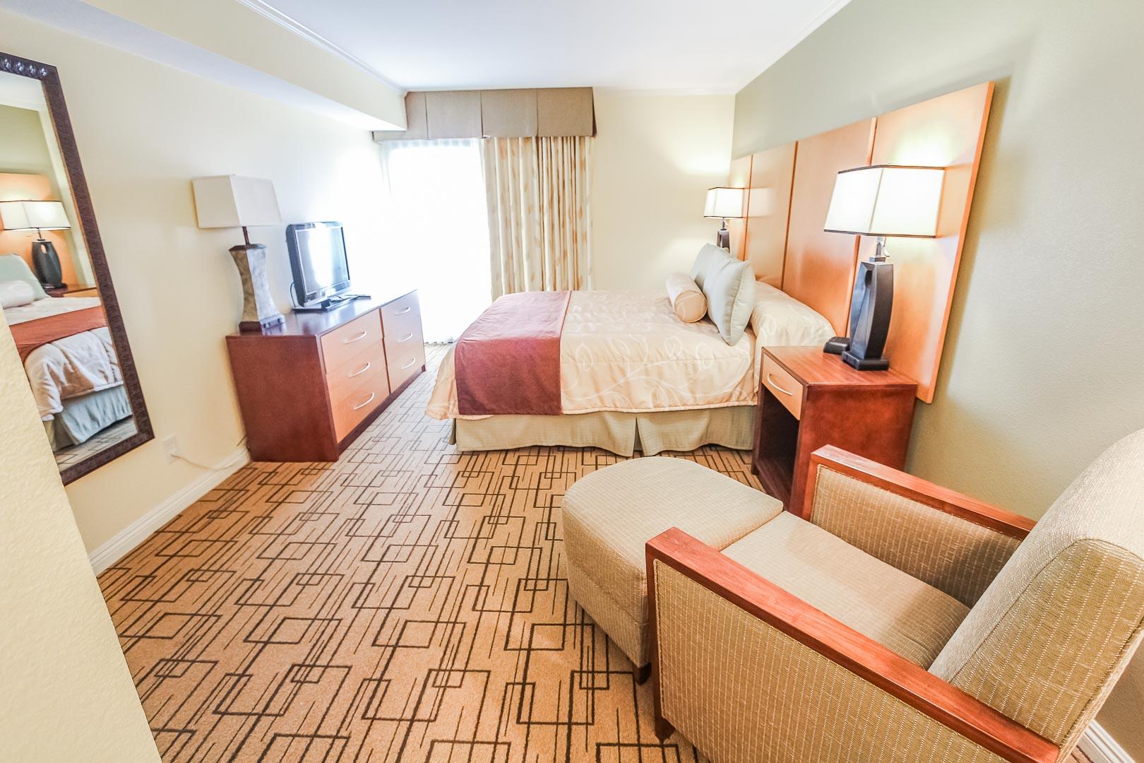A spacious master bedroom at VRI's Winner Circle Resort in California.