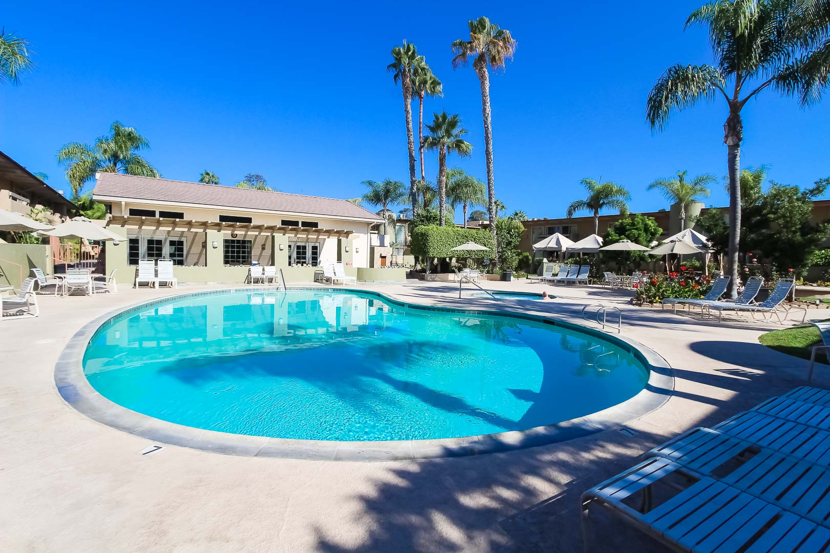 Clear skies and a clean outdoor swimming pool at VRI's Winner Circle Resort in California.