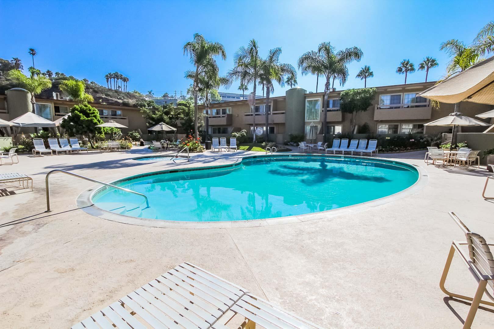 A crisp outdoor swimming pool at VRI's Winner Circle Resort in California.