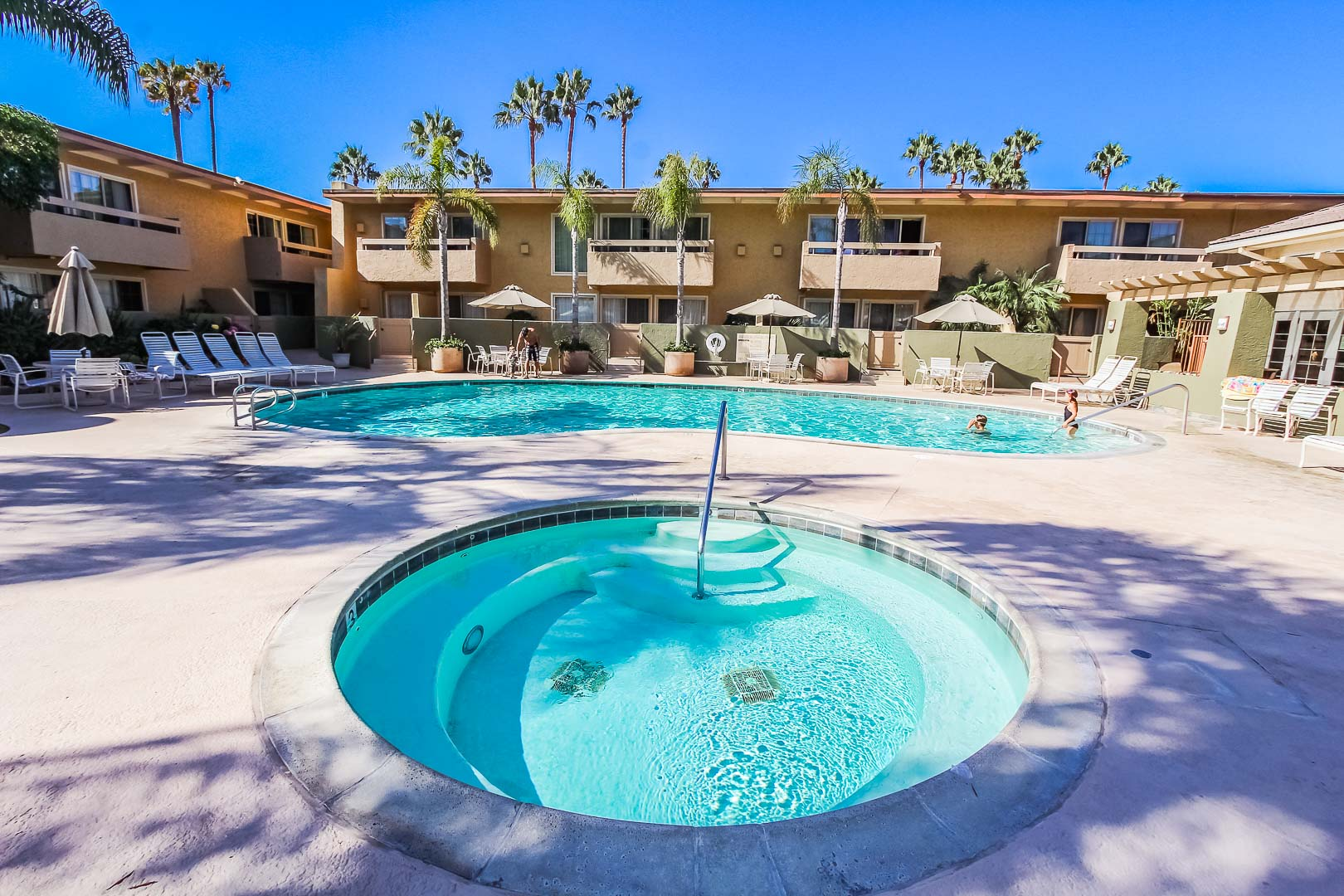 A view of the outdoor swimming pool and Jacuzzi at VRI's Winner Circle Resort in California.