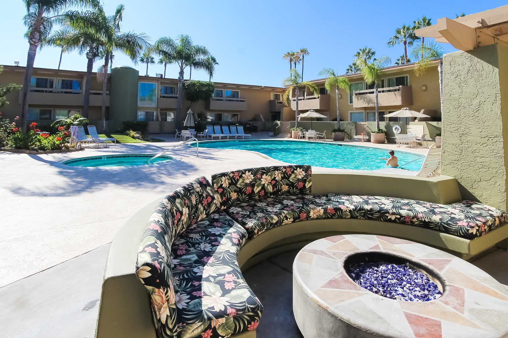 A bonfire pit next to the outdoor swimming pool at VRI's Winner Circle Resort in California.