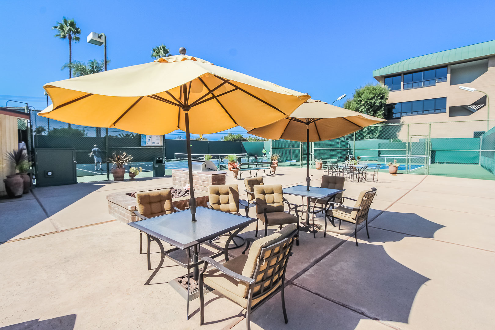 A lounging area next to the tennis courts at VRI's Winner Circle Resort in California.