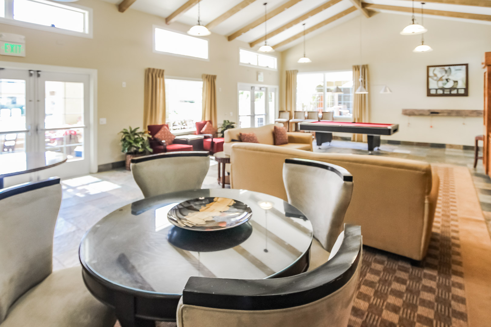 A pool table and lounging area at VRI's Winner Circle Resort in California.