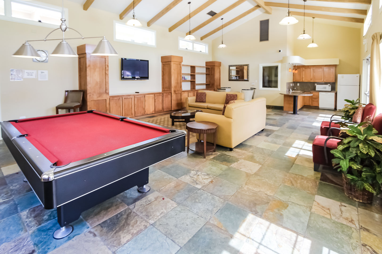A community area with a pool table at VRI's Winner Circle Resort in California.